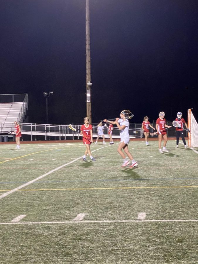 Kate DiFranco '23 prepares to pass the ball while playing attack.