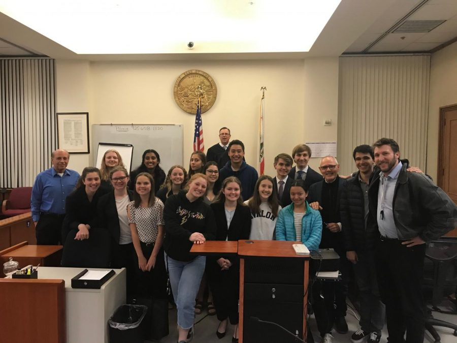 Members+of+the+prosecution+and+defense+team+smile+for+a+photo+after+their+trial+against+Monte+Vista.+