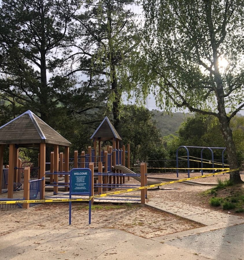 Caution tape surrounds the play structures at the Orinda Community Park.